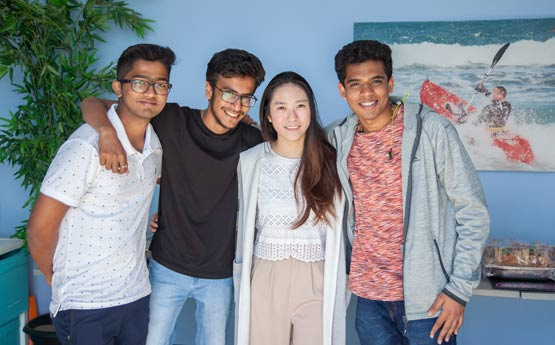Four International students in a group