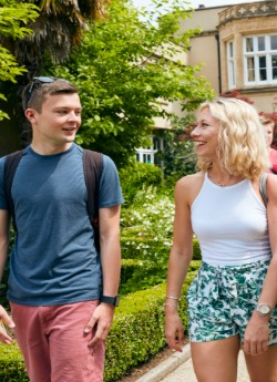 Male and female student walking outside Singleton Abbey