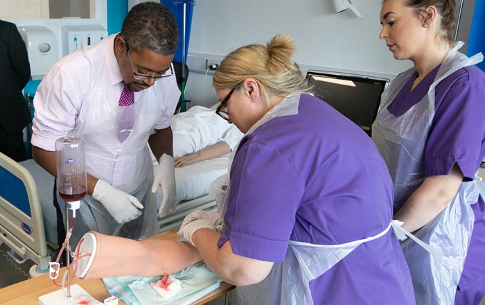 Student nurses demonstrate to Health Minister Vaughan Gething how to take blood using high-tech simulation models during the official opening of the Aneurin Bevan Clinical Skills Centre at Singleton Hospital.