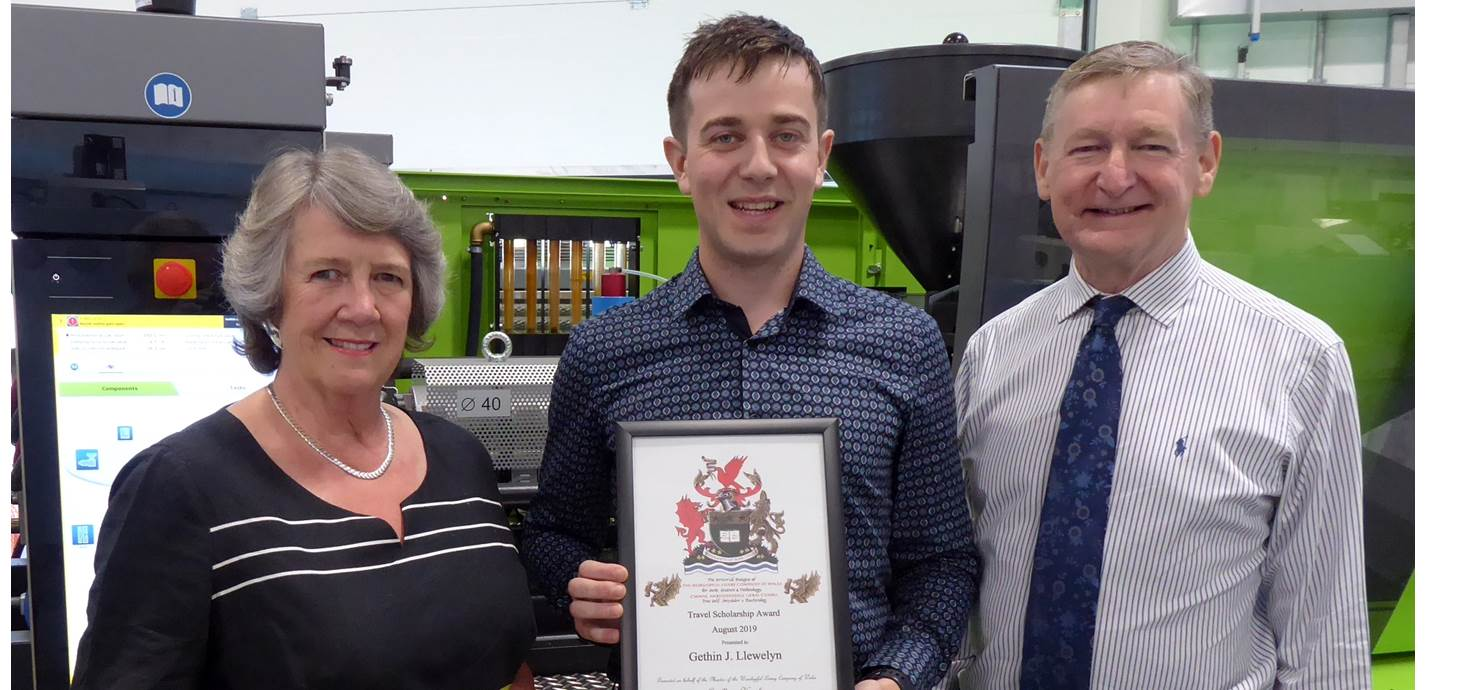 Gethin Llewelyn of Swansea University College of Engineering, being presented with a travel scholarship award by Sylvia Robert-Sargeant and Simon Holt of the Worshipful Livery Company of Wales.