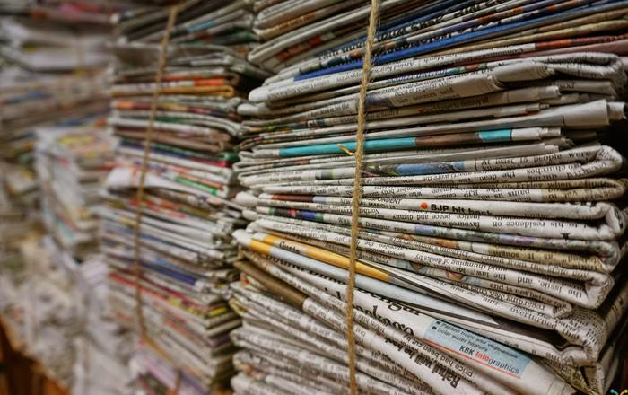 Image of stacked newspapers