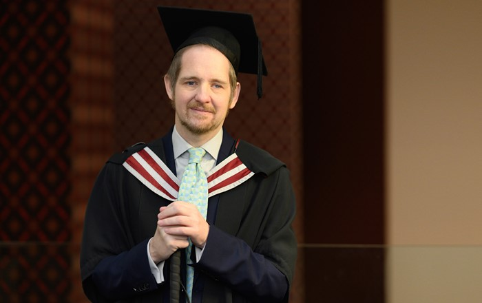 Student overcomes life-changing health setbacks to secure Master's