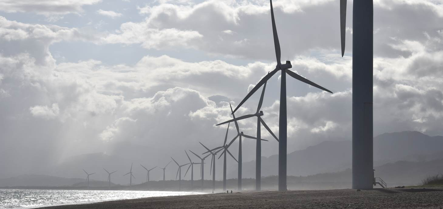 Wind turbines on a beach - Swansea research helps integrate renewables into the power grid
