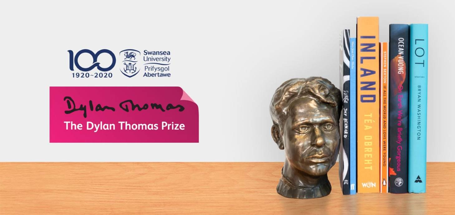 Six books on this year's shortlist next to a bust of Dylan Thomas