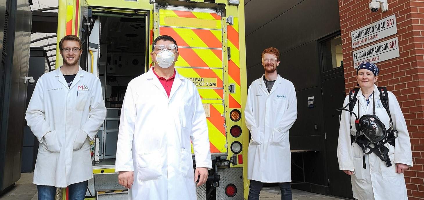 (L-r) Ed Lester-Card, Dr Chedly Tizaoui, Anthony Lewis and Dr Karen Perkins of Swansea University College of Engineering, with the demonstration ambulance used to test out their speed-cleaning procedure