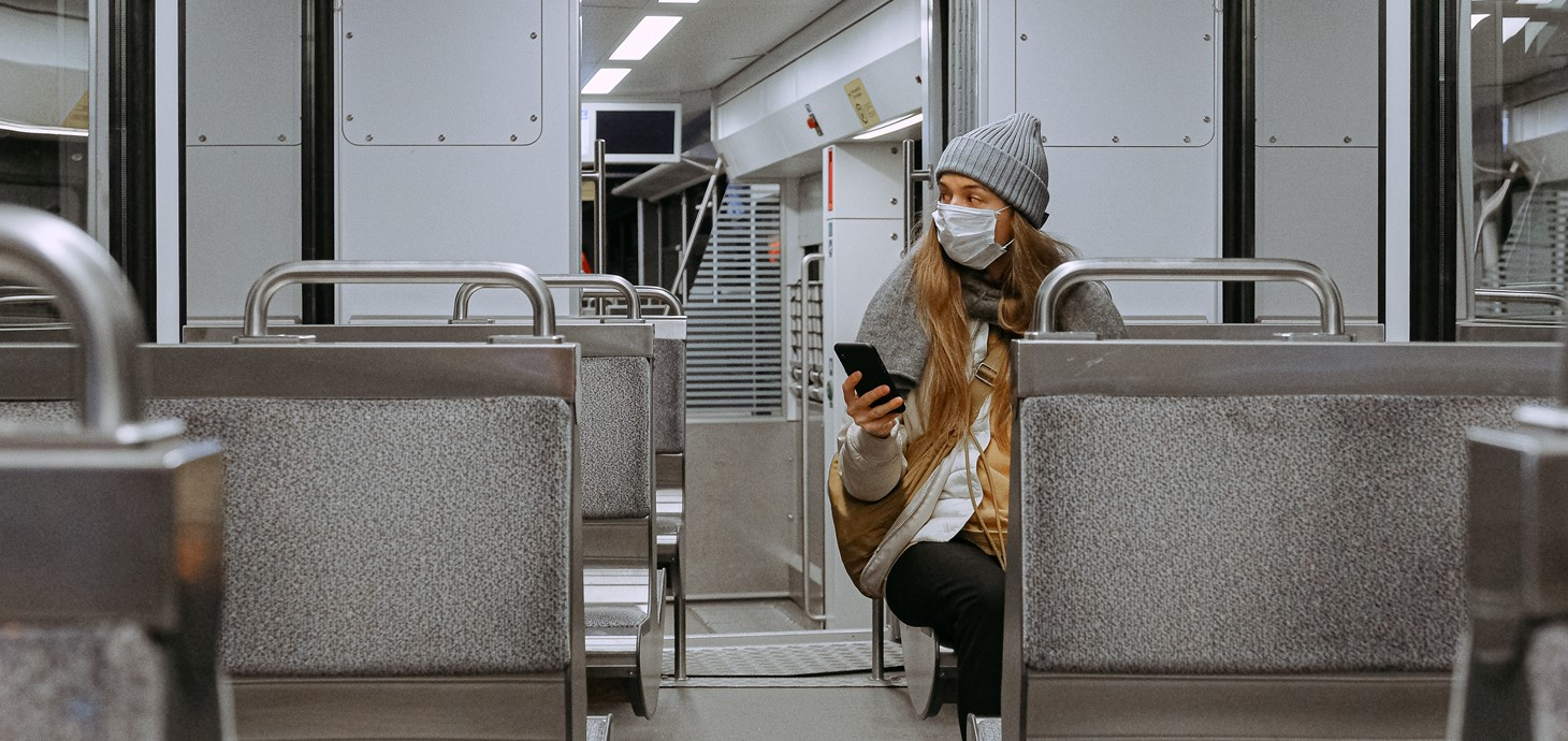 A woman sitting on her own in a train carriage during the coronavirus crisis.