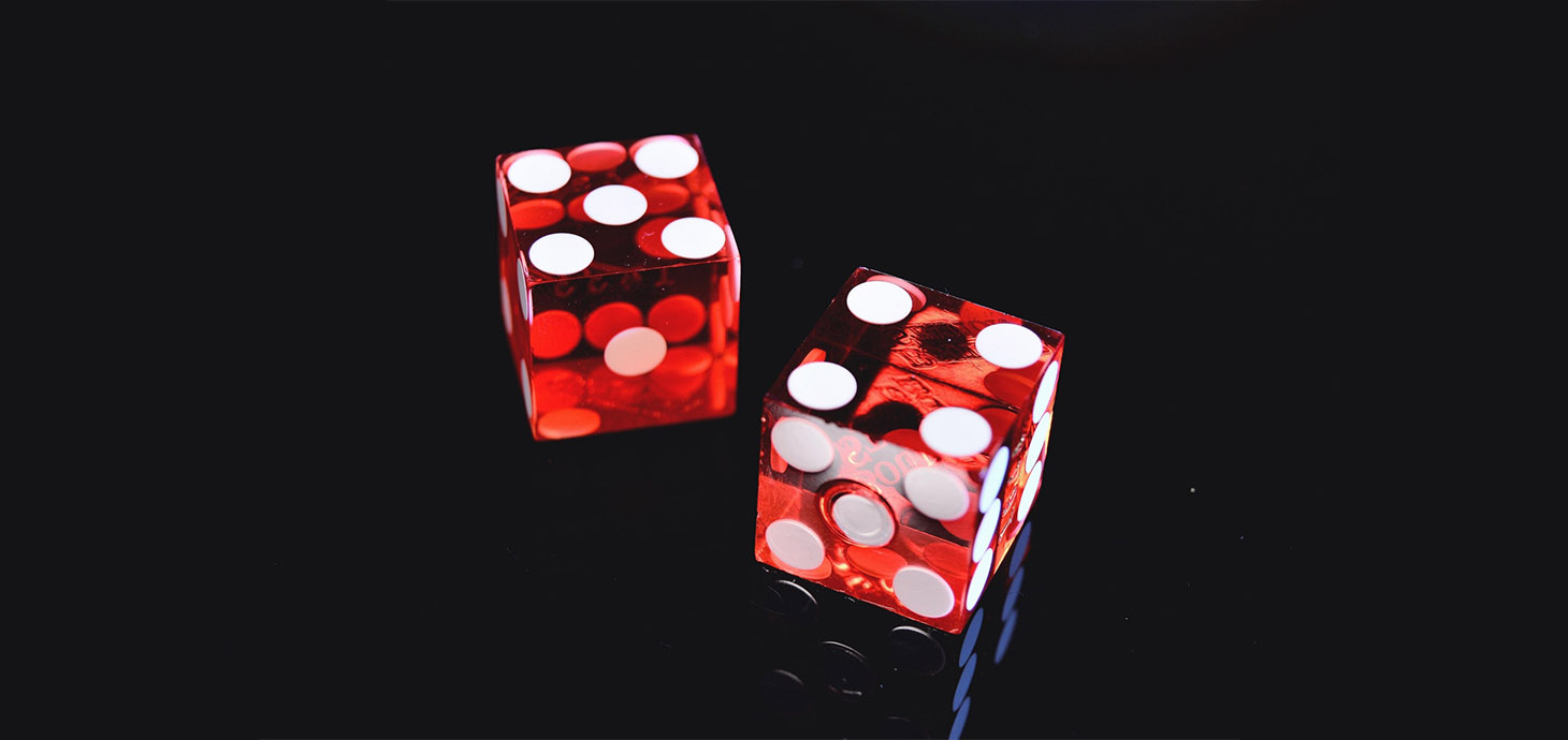 Picture shows two red dice.