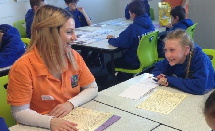 Student leader works with a primary pupil