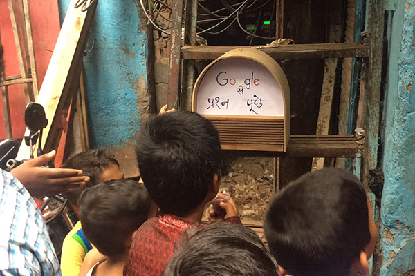 Children in Mumbai with made Google postbox smart speaker