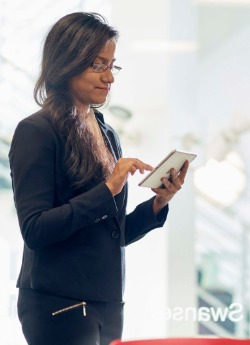 Woman in meeting room with an iPad