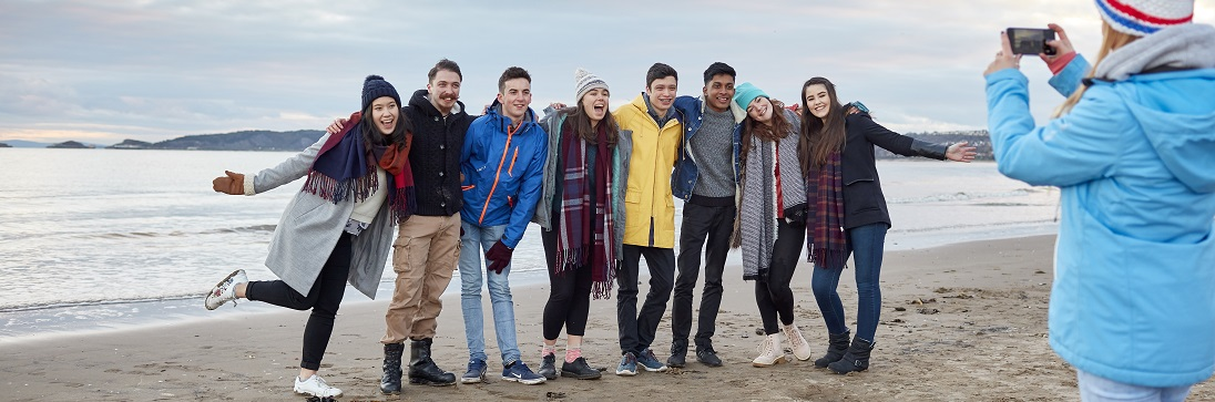 Image of students on the beach