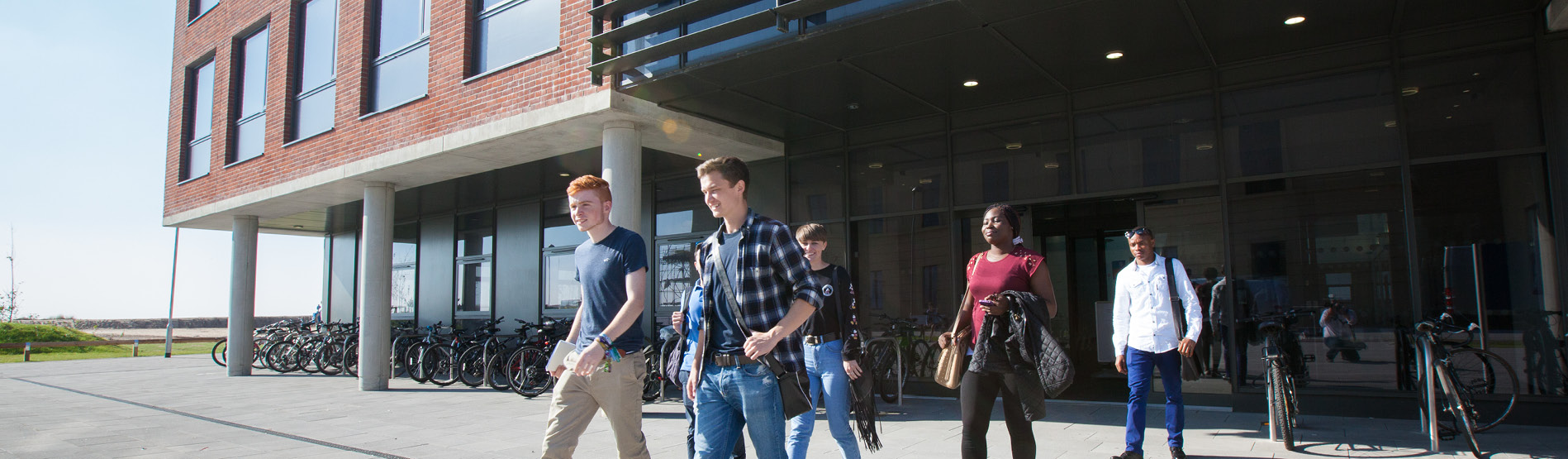group of students walking out of a building