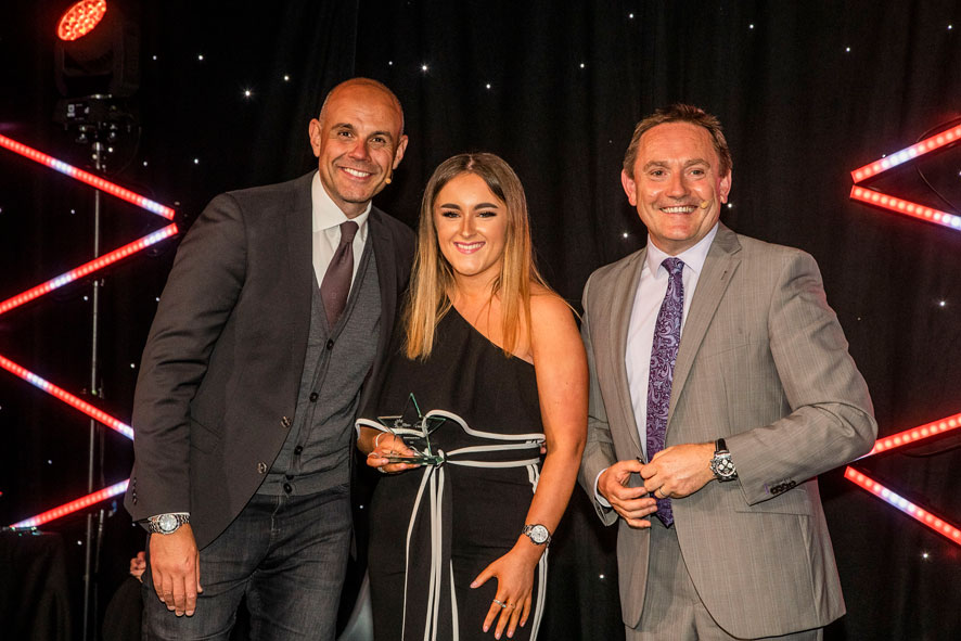 Melissa Molyneaux receiving her award from David Jones (Chief Executive of Cambria) and Jason Mohammad (Special Guest at the ceremony).