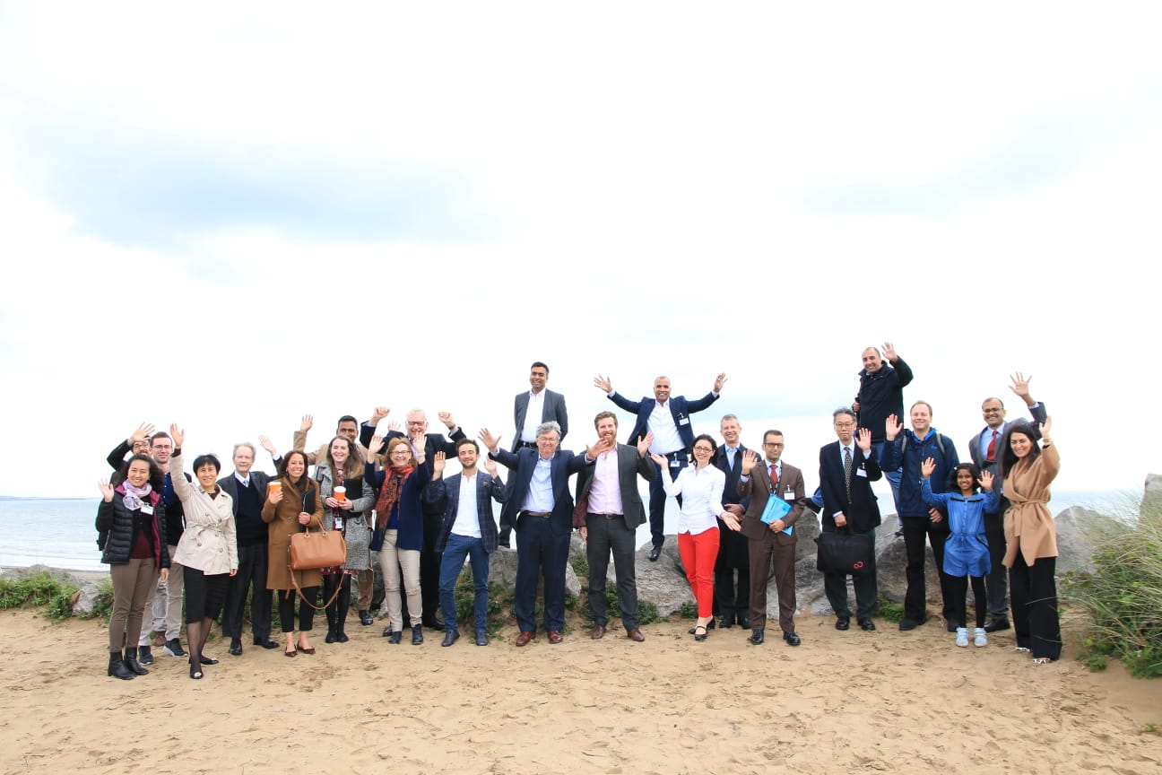 Participants posing on the beach