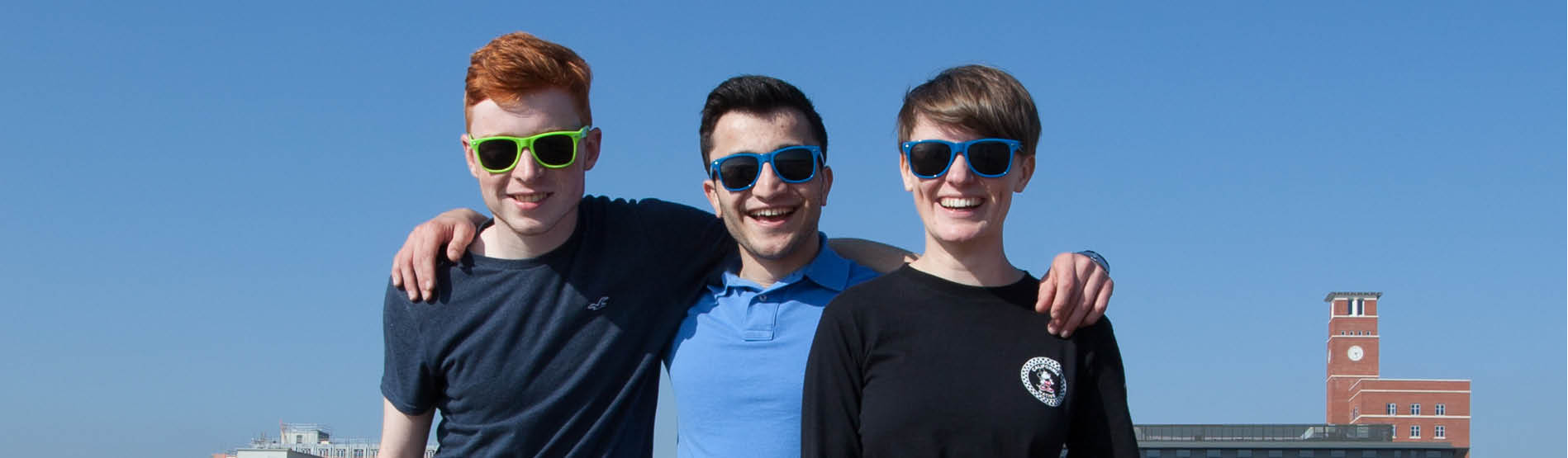 group of students smiling with sunglasses on