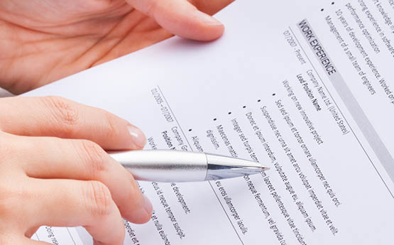 close up of a CV with someone writing on it