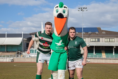 Rugby players with mascot