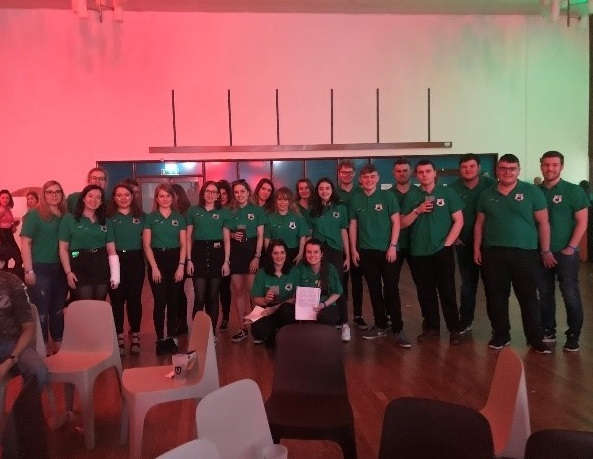 Welsh society students taking a photo in their green t-shirts for the Eisteddfod in 2019