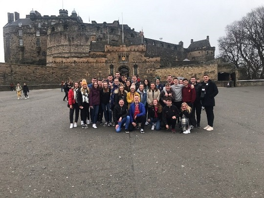 Students taking a photo in front of Edinburgh Castle