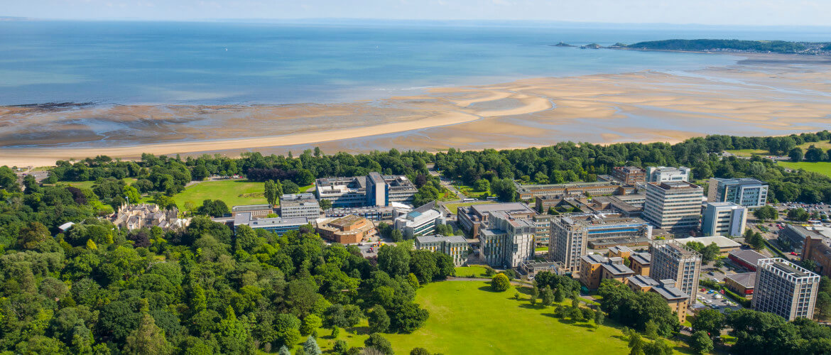 image of Swansea Bay from Singleton Park with Singleton campus in shot