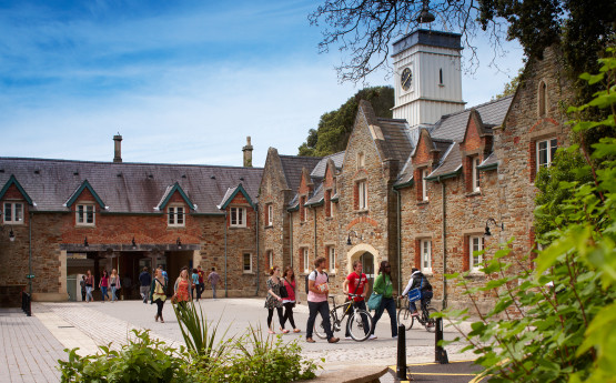 Photograph of Singleton Abbey Stable block with students walking by