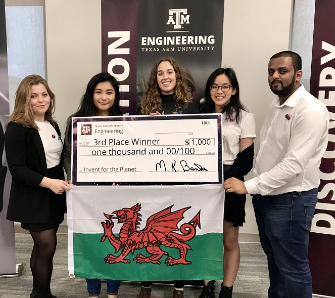Students holding Welsh flag and 3rd place cheque for $1000