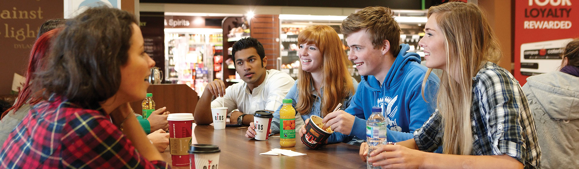 Students socialising during lunch in an on-campus cafe.