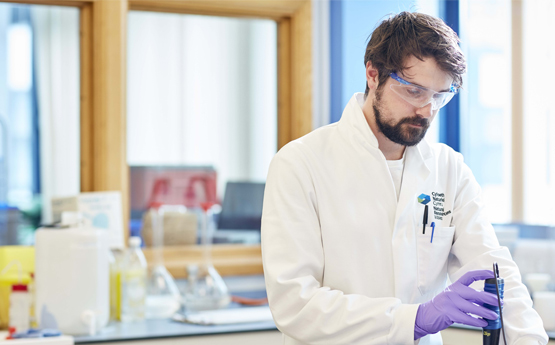 Swansea Uni student in a research lab